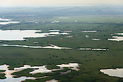 Nederland, Flevoland, Gemeente Lelystad, 27-08-2013; Oostvaardersplassen met Krentenplas (li boven).<br /> Bird sanctuary and nature reserve Oostvaardersplassen north-east of the city of Almere.<br /> luchtfoto (toeslag op standaard tarieven);<br /> aerial photo (additional fee required);<br /> copyright foto/photo Siebe Swart.
