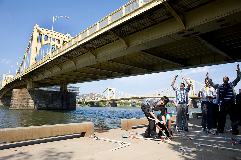 City Charter High School Matyas Feher (left) prepares to launch his paper rocket while his classmates cheer beneath the Andy Warhol Bridge at Allegheny Riverfront Park during engineering class. The students were learning about flight engineering.