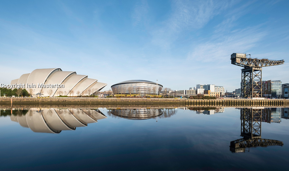 View SEC Armadillo and SE Hydro beside River Clyde on blue sky winter day, Scotland, United Kingdom