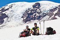 Resting climbers on Mount Rainier, Washington, USA.