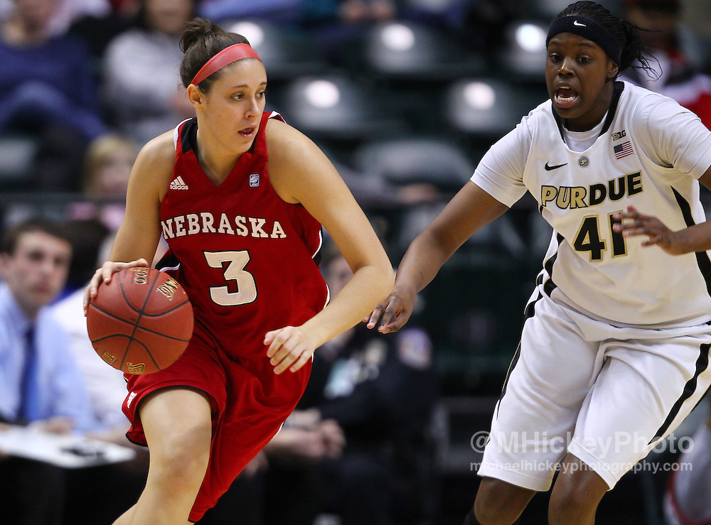 March 04, 2012; Indianapolis, IN, USA; Nebraska Cornhuskers forward Hailie Sample (3) dribbles against Purdue Boilermakers forward Alex Guyton (41) during the finals of the 2012 Big Ten Tournament at Bankers Life Fieldhouse. Purdue defeated Nebraska 74-70 in 2OT. Mandatory credit: Michael Hickey-US PRESSWIRE