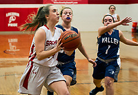 Laconia's Rebecca Howe gets to the basket ahead of Merrmack Valley's Abby Grandmaison and Sara Osborne during NHIAA Division III basketball Wednesday evening.  (Karen Bobotas/for the Laconia Daily Sun)