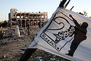 "A Hamas ""Gaza Unity"" banner stands near the destroyed Rafah Central Police headquarters complex in Rafah, Gaza January 15, 2009. Despite calls for unity, the rift between the Palestinian factions of HAMAS and Fatah is seen by many to be widening more than ever. Photo by Scott Nelson/World Picture Network for the New York Times."
