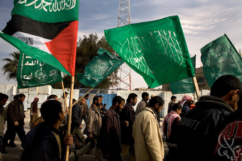 Palestinians wave HAMAS flags as they carry the body a 12 year old boy killed during an Israeli airstrike to the graveyard during a January 16, 2009 funeral  in Rafah Gaza. The Israeli Defense Forces claim their sustained campaign has significantly degraded smuggling tunnels along  the corridor and the damaged the ability of HAMAS to smuggle weapons and cash into the Strip, but it has also killed civilians unlucky to have been still in the vicinity of targeted neighborhoods. (photo by Scott Nelson, World Picture Network for the New York Times)