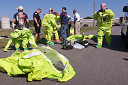 New Hampton, New York -  The Orange County Hazardous Materials (HAZMAT) Response Team suits up during a drill to practices responding to a tanker railcar leak at the Orange County Fire Training Center on Aug. 9, 2014.