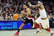 Feb. 5, 2011; Cleveland, OH, USA; Portland Trail Blazers point guard Patrick Mills (8) drives past Cleveland Cavaliers point guard Daniel Gibson (1) during the third quarter at Quicken Loans Arena. The Trail Blazers beat the Cavaliers 111-105. Mandatory Credit: Jason Miller-US PRESSWIRE