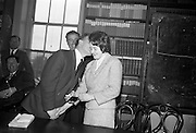 """06/05/1965<br /> 05/06/1965<br /> 06 May 1965<br /> Presentation of the Read Cup for quality Butter production at the RDS, Ballsbridge, Dublin. Image shows Mr Charles Haughey,  Minister for Agriculture giving a """"peck on the cheek"""" to Miss Maura Harrington, Castletownbere Buttermakers Creamery as he presents a medal to her."""
