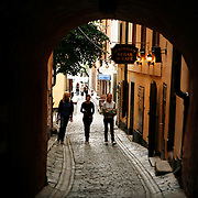 "Gåsgränd, ""Goose Alley"", in Gamla Stan, the old town in central Stockholm, Sweden. In the 15th and 16th century, the alley was named Grågåsens gränd, ""Alley of the Grey-Goose"",  after a woman, Ragnhild Grågås, who lived in the alley around 1500.<br /> Jose More Photography"