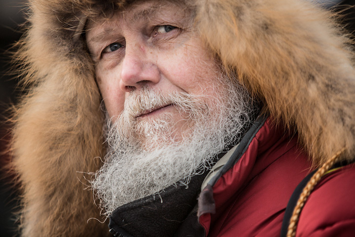 Anchorage Daily News Photographer Bob Hallinen is on the lookout for Rondy images in downtown Anchorage
