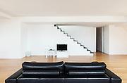 Interior, beautiful loft, hardwood floor, black divan