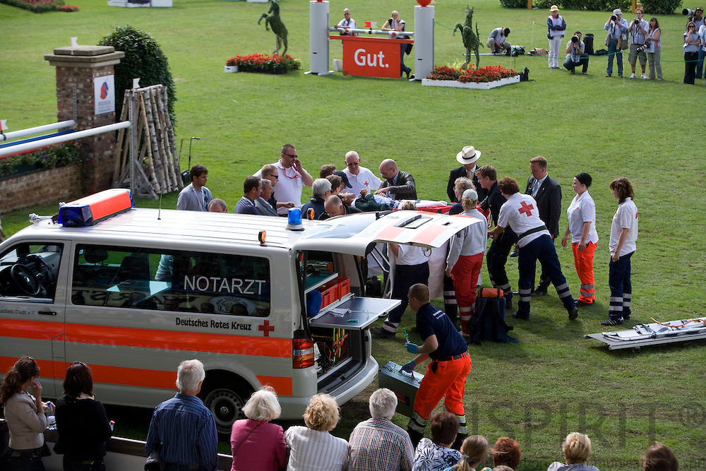 AACHEN - GERMANY - 04 JULY 2008 --  World Equestrian Festival, CHIO Aachen 2008 -- Alvaro MIRANDA from Brasilia ends up falling with his horse Ad Ornella trying to jump this fence. He was taken to hospital by ambulance and the horse seemed to be fine after being calmed. Photo: Erik Luntang