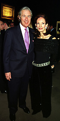 MR & MRS MARTIN SUMMERS, he is the art dealer, at a party in London on 17th January 2000.OAD 2