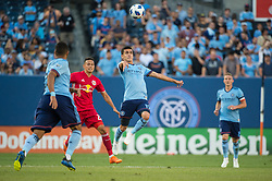 July 8, 2018 - Bronx, New York, United States - New York City forward JESUS MEDINA (19) looks to control the ball while New York Red Bulls midfielder SEAN DAVIS (27) looks on during a regular season match at Yankee Stadium in Bronx, NY.  New York City FC defeats the New York Red Bulls 1 to 0 (Credit Image: © Mark Smith via ZUMA Wire)