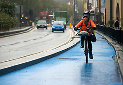 © Licensed to London News Pictures.06/11/2013. London, UK. A cyclist rides her bicycle on London's first segregated section of Barclays Cycle Superhighway that has been launched at Stratford High Street.Photo credit : Peter Kollanyi/LNP