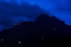 13.06.2015, Spitzkofel, Lienz, AUT, Jedes Jahr steigen Bergsteiger für die Gemeinde Leisach auf den Gipfel und die Türme des Spitzkofel um dort die Herz-Jesu-Feuer aufzustellen. Zurkückzuführen sind die Feuer auf einen in Bozen, im Jahr 1796, entstandener Brauch und hängt mit der Herz-Jesu-Verehrung zusammen Als beim Tiroler Volksaufstand Andreas Hofer´s Truppen gegen Frankreich siegreich waren wurde der Herz-Jesu-Sonntag damals zum hohen Feiertag, im Bild der Spitzkofel mit Feuer, EXPA Pictures © 2015, PhotoCredit: EXPA/ Michael Gruber
