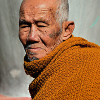 Profile of Very Old Monk in Ban Xang Hai in Laos<br /> When I gestured to this elder monk whether I could take his photo, he stood there calmly without a word or emotion.  I was mesmerized by his inner peace and the wisdom etched on his face.  He clearly had reached the Fourth Path of a Buddhist monk called Arhat which, among many other things, is characterized by a constant feeling of good will for all beings.