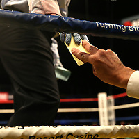 A judge hands his scorecard to the referee during Showtime Televisions ShoBox:The Next Generation boxing match at the Event Center at Turning Stone Resort Casino on Friday, February 28, 2014 in Verona, New York.  (AP Photo/Alex Menendez)