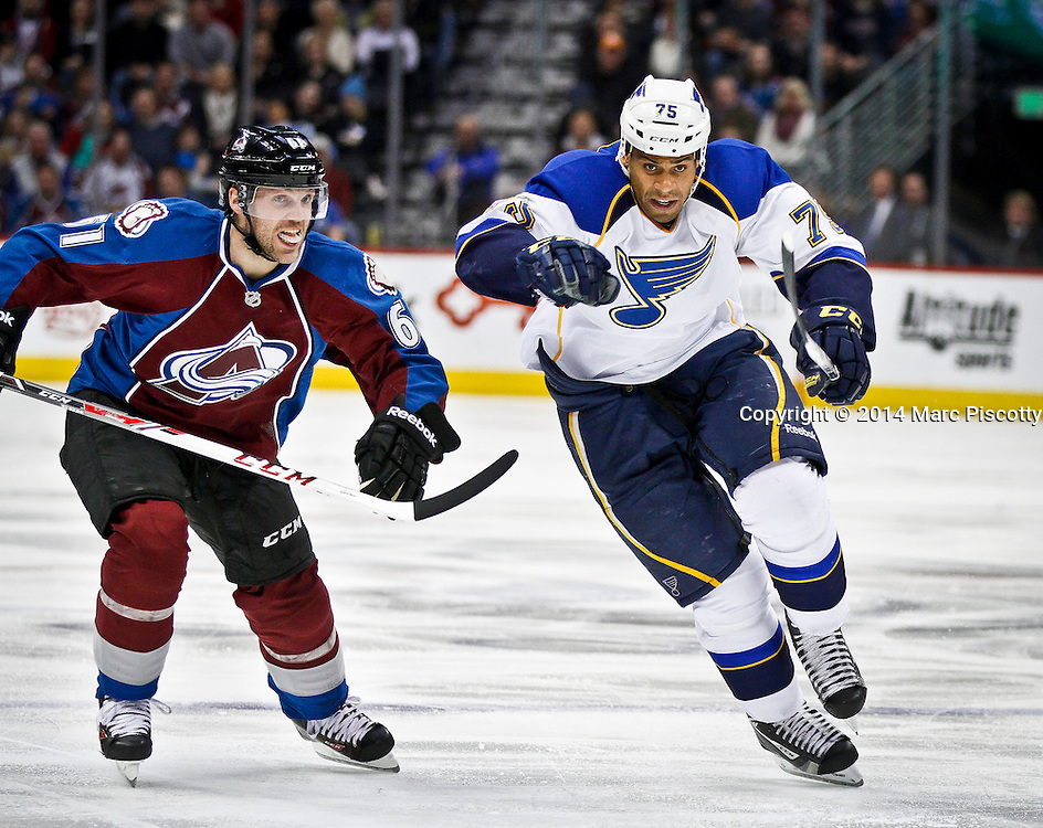 SHOT 3/8/14 3:59:54 PM - The Colorado Avalanche's Andre Benoit #61 tries to slow down the rush of the St. Louis Blues' Ryan Reaves #75 during their regular season Western Conference game at the Pepsi Center in Denver, Co. The Blues won the game 2-1.<br /> (Photo by Marc Piscotty / &copy; 2014)
