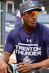 July 5, 2017 - Trenton, New Jersey, U.S - JORGE MATEO of the Trenton Thunder takes a brief break in the dugout to drink some water between fielding practice and batting practice, before the game here tonight at ARM & HAMMER Park vs. the Fightin Phils. (Credit Image: © Staton Rabin via ZUMA Wire)