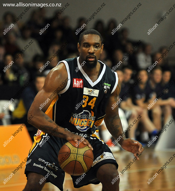 Akeem Wright starts a play, in the NBL match, between the Otago Nuggets and Hawkes Bay, Lion Foundation Arena, Edgar Centre, Dunedin, Otago, New Zealand, Friday, May 24, 2013. Credit: Joe Allison / Allison Images.