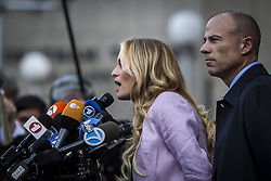April 16, 2018 - New York, New York, United States - Outside a federal courthouse in Manhattan, Stephanie Clifford, also known as porn star Stormy Daniels, and her attorney, Michael Avenatti, give a brief but sharp comment after Monday's hearing with President Donald Trump's longtime lawyer Michael Cohen. (Credit Image: © Michael Nigro/Pacific Press via ZUMA Wire)