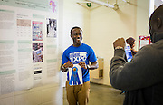 Kingsley Antwi-Boasiako, a PhD student in Media Studies, poses for a photo with his first place ribbon after the Ohio University Student Expo on Thursday, April 10, 2015.  Antwi-Boasiako's research focused on newspaper coverage of Ebola in Western African countries.   Photo by Ohio University  /  Rob Hardin