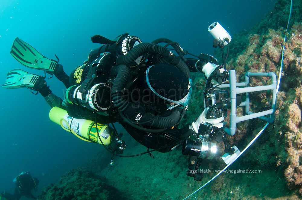 underwater researchers taking images of a quadrant in order to measure invertabrates and alge presence and covering percentage