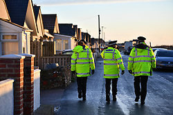 © Licensed to London News Pictures. 13/01/2017. Jaywick, UK. Police officers patrol the seafront at Jaywick before Homes are evacuated in Jaywick, Essex  due to the threat of flooding in low-lying areas . Photo credit: Ben Cawthra/LNP