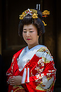 The use or rental of traditional clothes for weddings in Japan, albeit expensive, is still very much in use. Here a bride poses in traditional garb.
