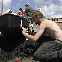 Kieran Clancy From Kilkee Co.Clare painting on the Number on the Currachs  before the Start of the Currachs Racing in Cappa Co.Clare.<br /> Pic.Brian Gavin/Press 22