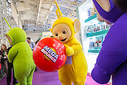 UNITED KINGDOM, London: 25 January 2016 The Teletubbies play with a giant bouncy ball at The Toy Fair at Olympia, the UK'S only dedicated game and hobby event with more than 260 toy and gaming brands. The fair runs until tomorrow. Rick Findler / Story Picture Agency