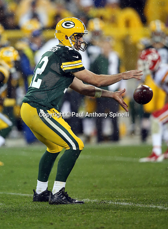 Green Bay Packers quarterback Aaron Rodgers (12) catches a snap in the shotgun formation during the 2015 NFL week 3 regular season football game against the Kansas City Chiefs on Monday, Sept. 28, 2015 in Green Bay, Wis. The Packers won the game 38-28. (©Paul Anthony Spinelli)
