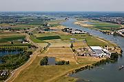 Nederland, Gelderland, gemeente Buren, 08-07-2010; Neder-Rijn, De Tollewaard met steenfabriek. In het kader van het Programma Ruimte voor de Rivier zijn er plannen om de uiterwaard te vergraven: door de uiterwaard komt een nevengeul, links van de huidige fabrieksterreinen..Under the Program 'Room for the River', there are plans to construct a flood trench, left of the factory sites..luchtfoto (toeslag), aerial photo (additional fee required).foto/photo Siebe Swart.