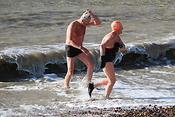 © Licensed to London News Pictures. 24/01/2015. Brighton, UK. Members of the Brighton and Hove Sea Swimming Club taking part in their daily exercise. A sunny day in Brighton and the South Coast with temperatures expected to reach a maximum of 7C down the South Coast. Photo credit : Hugo Michiels/LNP