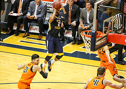 Feb 10, 2018; Morgantown, WV, USA; West Virginia Mountaineers guard Jevon Carter (2) shoots a jumper during the first half against the Oklahoma State Cowboys at WVU Coliseum. Mandatory Credit: Ben Queen-USA TODAY Sports