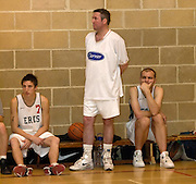 DAGENHAM - MAY 17: Barking and Dagenham Erkenwald Basketball Club's Robin French (#7), Declan McCusker (standing) and Lee Atkinson (on right) watch the action from the bench during the Essex Metropolitan Basketball League's Play Off final against Cardinals at Sydney Russell School. Erks won the game 81 - 68.