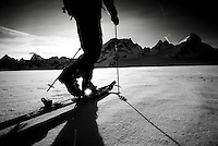 A skier traverses the Mont Collon Glacier, Haute Route, Switzerland.