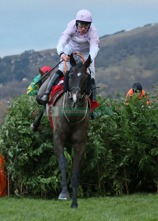 Bless the Wings ridden by Davy Russel on their way to winning The Glenfarclas Cross Country Handicap Steeple Chase during day one of The International meeting at Cheltenham Racecourse.
