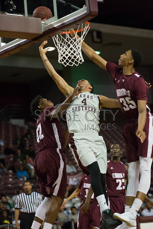 Jose Rodriquez of TSU goes up over Alabama A&M defenders. TSU defeats Alabama A&M 77-54 at the HP&E Arena in Houston, Texas. Photo By: Jerome Hicks/ Space City Images