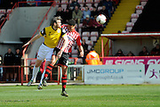 Northampton Town's Zander Diamond gets a header on target which forces a save ferom Exeter City's Robert Olejnik during the Sky Bet League 2 match between Exeter City and Northampton Town at St James' Park, Exeter, England on 16 April 2016. Photo by Graham Hunt.