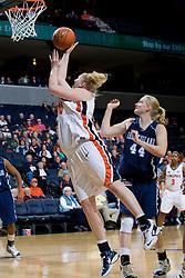 Virginia forward/center Abby Robertson (30) shoots past Rhode Island forward Erin Cournoyer (44).  The Virginia Cavaliers women's basketball team defeated the Rhode Island Rams 89-53 at the John Paul Jones Arena in Charlottesville, VA on January 9, 2008.