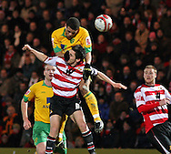 Doncaster - Friday January 30th 2009:Darel Russell of Norwich City gets to grips with Brian Stock of Doncaster Rovers during the Coca Cola Championship Match at The Keepmoat Stadium Doncaster. (Pic by Steven Price/Focus Images)