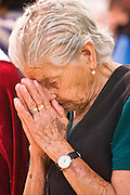 08 APRIL 2004 - SAN MIGUEL DE ALLENDE, GUANAJUATO, MEXICO: A woman prays during Holy Thursday services in the Church of the Oratorio in San Miguel de Allende, GTO, MEX. Semana Santa, the week before Easter, is celebrated with extreme piety in central Mexico. San Miguel, which was founded in the 1600s, is one of Mexico's premier colonial cities. It has very strict zoning and building codes meant to preserve the historic nature of the city center. About 7,500 US citizens, mostly retirees, live in San Miguel. PHOTO BY JACK KURTZ