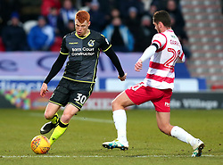 Rory Gaffney of Bristol Rovers takes on Tyler Garrett of Doncaster Rovers - Mandatory by-line: Robbie Stephenson/JMP - 27/01/2018 - FOOTBALL - The Keepmoat Stadium - Doncaster, England - Doncaster Rovers v Bristol Rovers - Sky Bet League One