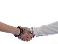 handshake with handcuffs concept agreement isolated studio on white background