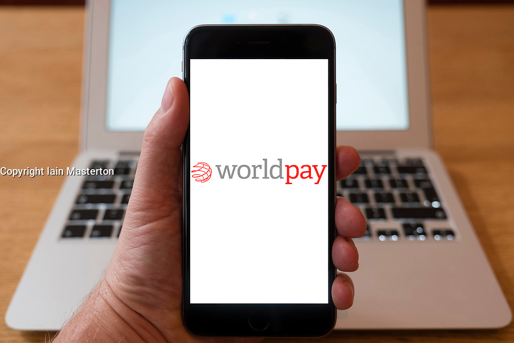 Using iPhone smartphone to display logo of Worldpay, payment processing company