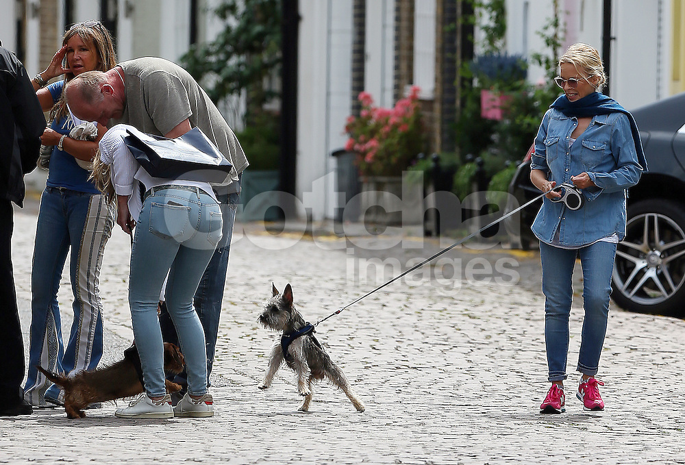 (EXCLUSIVE PICTURES) The lovely Kylie Minogue wearing double denim and a pair of bright New Balance trainers out and about in London. The pop princess was out walking her fiance Joshua Sasse's Alfred dog after a recent romantic getaway in Italy. London, UK. 03/08/2016<br />
