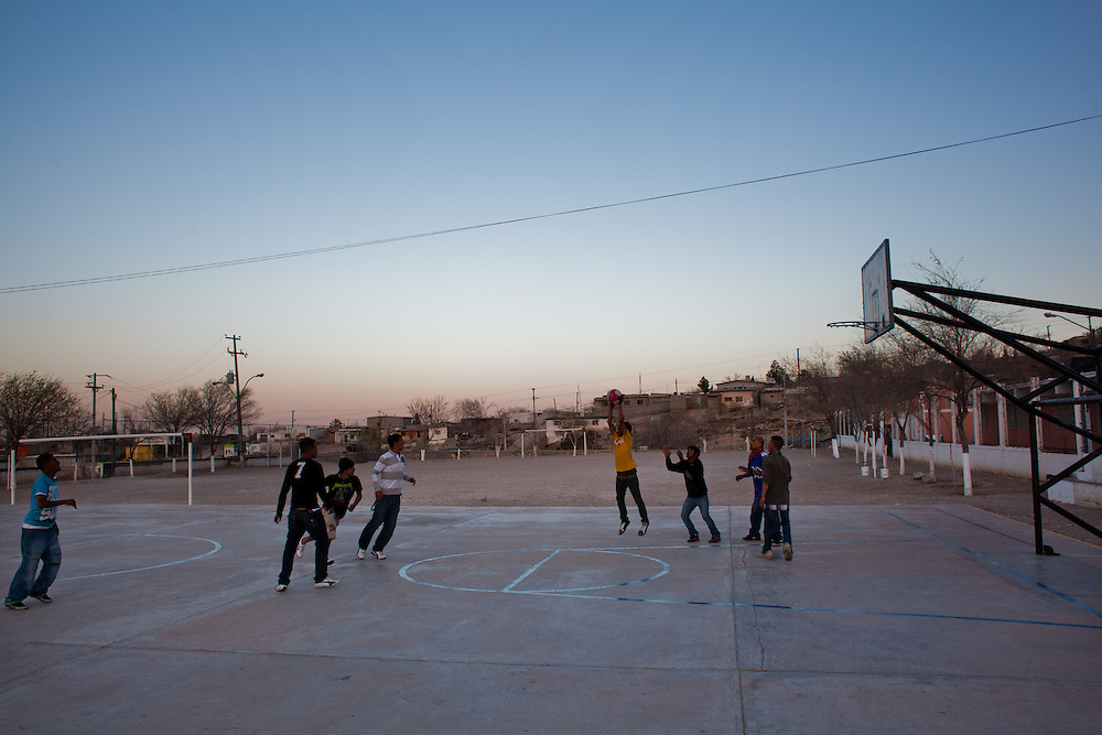 "Youth, primarily of the gang ""Los Noveno"" hang out in a soccer field in the Diaz Ordaz colonia, one of the poorest communities of Ciudad Juarez. Within the last two months one of their members was murdered."