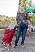 outdoors farmers market food shopper portrait during Covid 19 crisis France Limoux May 2020