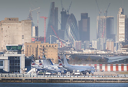 © Licensed to London News Pictures. 12/02/2018. London, UK. Aircraft line up at London City Airport which remains closed after a World War II era bomb was found in The River Thames during routine work on nearby King V Dock. Police have evacuated nearby residents, closed the airport and set up a 214-metre exclusion zone. Photo credit: Peter Macdiarmid/LNP